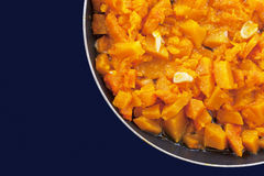Roasted pumpkin with garlic in a pan Stock Image