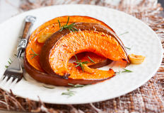 Roasted pumpkin. With garlic and rosemary stock photography
