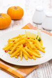Roasted pumpkin with lime and chilli on the plate Royalty Free Stock Photo