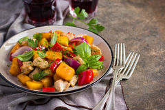 Roasted pumpkin, meat, bell peppers and red onion Stock Photography