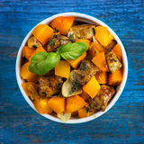 Roasted pumpkin and meat on the pan Stock Photo