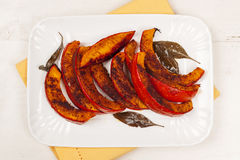 Roasted pumpkin on plate Royalty Free Stock Images