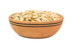 Free Roasted Pumpkin Seeds In A Wooden Bowl Stock Image - 131560361