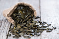 Free Roasted Pumpkin Seeds On Wood Stock Photography - 33814582