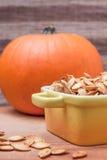 Roasted pumpkin seeds and pumpkin Stock Photos