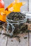 Roasted Pumpkin Seeds on wood Royalty Free Stock Images