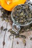 Roasted Pumpkin Seeds on wood Royalty Free Stock Photos