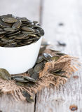 Roasted Pumpkin Seeds on wood Royalty Free Stock Photography