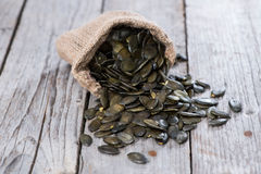 Roasted Pumpkin Seeds on wood Stock Images
