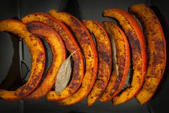 Roasted pumpkin slices Royalty Free Stock Images