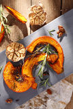 Roasted pumpkin. Tasty roasted pumpkin with herbs stock photo