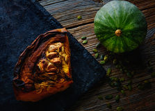 Roasted pumpkin on vintage tray in wooden table Royalty Free Stock Photos
