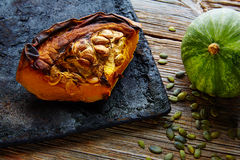 Roasted pumpkin on vintage tray in wooden table Royalty Free Stock Images