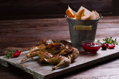 Roasted quail with a garnish. Royalty Free Stock Photo