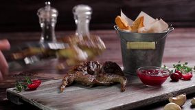 Roasted quail with a garnish. Roasted quail with a garnish on a wooden background. Exclusive dish stock video footage