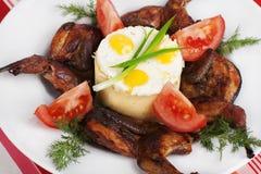 Roasted quail with mashed potatoes Stock Photo