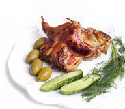 Roasted quail with vegetables on white plate Stock Photo