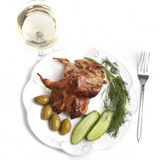 Roasted quail with vegetables and white wine Royalty Free Stock Photo