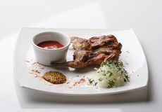 Roasted quail with white sauce Stock Images