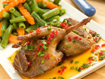 Roasted quails Stock Photos