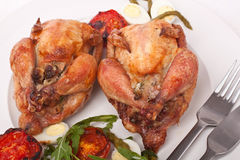 Roasted Quails Garnished with Vegetables Stock Photo