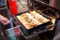 Quails preparing in the oven. Roasted quails preparing in the oven Stock Image