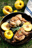 Roasted quails with quince Stock Images