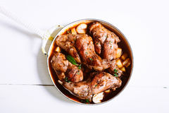 Roasted Rabbit Haunch in Pan with Fresh Herbs Stock Images