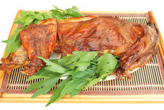 Roasted rabbit isolated. Roasted rabbit and lovage decoration isolated Royalty Free Stock Photography