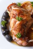 Roasted rabbit leg with oranges macro. Vertical top view Stock Images
