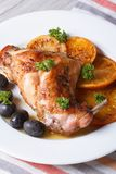 Roasted rabbit leg with oranges and olives on the plate. vertica Royalty Free Stock Photos
