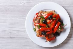 Roasted rabbit leg with peppers and olives top view horizontal Stock Image