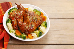 Roasted rabbit with vegetables Royalty Free Stock Images