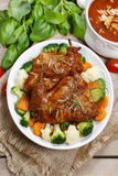 Roasted rabbit with vegetables Stock Photos