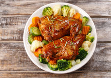 Roasted rabbit with vegetables Stock Photo