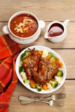 Roasted rabbit with vegetables Stock Image