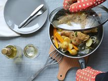 Roasted rabbit with vegetables on wine Stock Photos