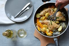 Roasted rabbit with vegetables on wine Stock Photo
