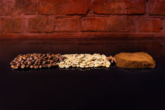 Roasted, Raw and Ground Coffee Beans on Black Royalty Free Stock Images