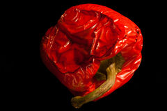 Roasted Red bell Pepper. On black background Royalty Free Stock Image