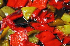 Roasted red and green peppers. Royalty Free Stock Photography