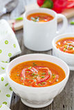 Roasted red pepper soup in white bowl Royalty Free Stock Image