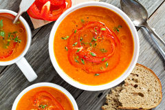 Roasted red pepper soup in white bowl Royalty Free Stock Photography