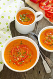 Roasted red pepper soup in white bowl Stock Photos