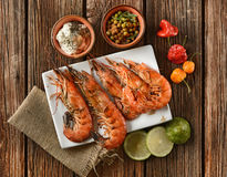 Roasted red prawns with ingredients around Stock Image