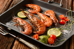Roasted red prawns with ingredients around Royalty Free Stock Photography