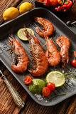 Roasted red prawns with ingredients around Royalty Free Stock Photos