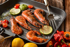 Roasted red prawns with ingredients around Stock Photos