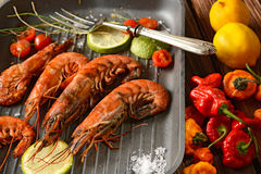 Roasted red prawns with ingredients around Royalty Free Stock Photo