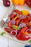 Roasted red and yellow bell pepper with purple onion Royalty Free Stock Image